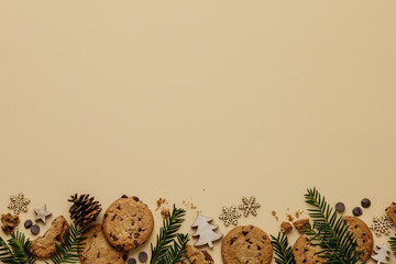 Christmas background with Chocolate chip cookies and wooden decorations