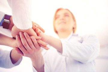Medical doctors shaking hands, bottom view. Medical and healthcare concept