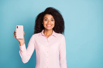 Photo of amazing wavy dark skin lady holding telephone hand demonstrating new smart phone case...