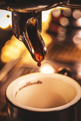 Espresso pouring from coffee machine