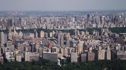 Wall Mural - Aerial view of New York City in slow motion. Central Park and Midtown skyline in Manhattan as seen from helicopter