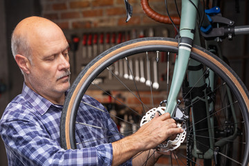 Mechanic working on the wheel of a bicycle