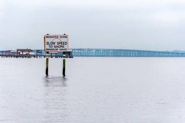 Slow Speed sign in an open river around Jacksonville Florida, USA