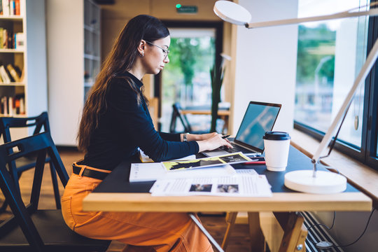Stylish woman working on laptop in office
