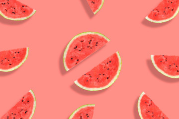 Flat lay of watermelon half slices on pink background. Watermelon pattern.