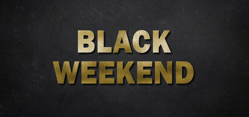 """text """"Black Friday"""" in golden letters on black background"""