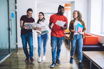 Contemporary diverse students with papers