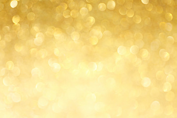 Golden sparkle glitters with bokeh effect and selectieve focus. Festive background with bright gold lights, champagne bubble. Christmas mood concept. Copy space, close up, texture, top view. Wall mural