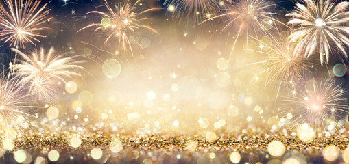 Wall Mural - Golden Glitter Background With Fireworks In The Night