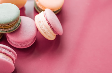French macaroons on pastel pink background, parisian chic cafe dessert, sweet food and cake macaron for luxury confectionery brand, holiday backdrop design