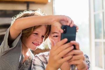 Siblings taking selfie