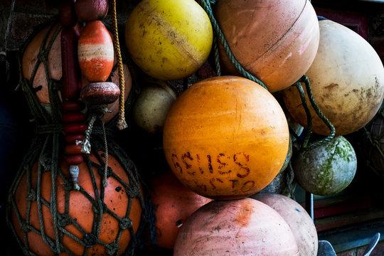 Close up of round plastic fishing buoys