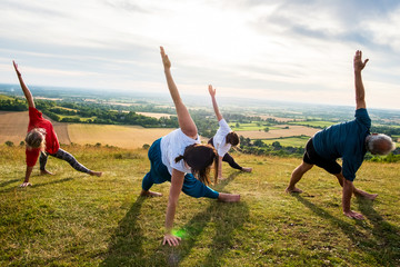 Women and man taking part in yoga class