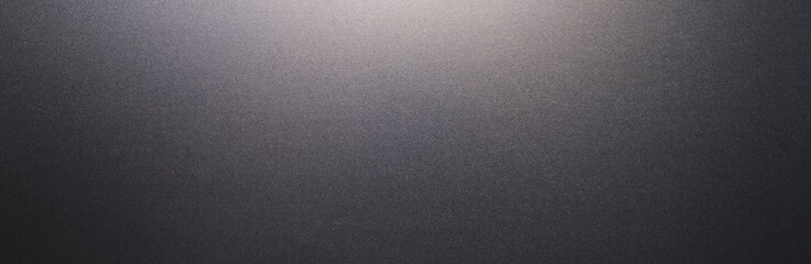 Black plastic texture or background or backdrop, banner size, with copyspace for your individual text.