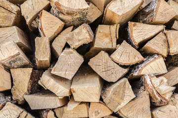 The wooden background closeup, pile of firewood
