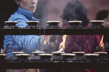 Closeup shot of people burning sage with a blurred background