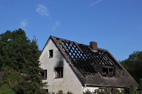 house fire,  burned roof truss, demolotion work, fire damage