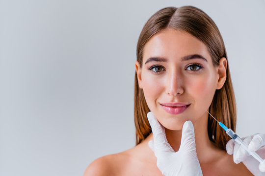 Woman face cosmetology or plastic surgery and beauty concept on background