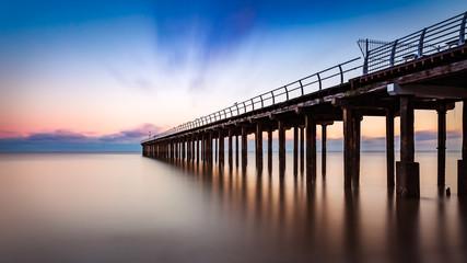 Foto op Aluminium Chocoladebruin Pier at sunrise