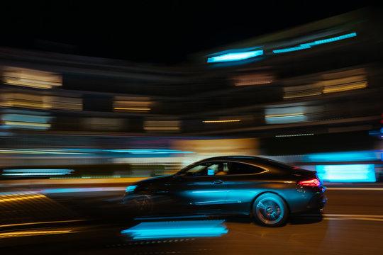 Monaco city night car traffic near Hotels and Casino