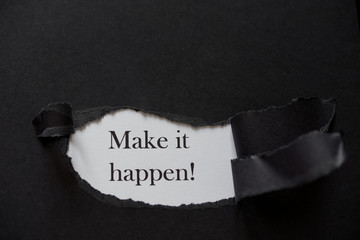 Word make it happen printed on a white background with black torn paper.