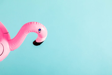Foto op Canvas Flamingo Summer beach composition. pink inflatable mini flamingo on pastel blue background, pool float party, trendy summer concept. Flat lay, top view, copy space