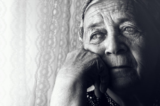 Depressed sad old woman