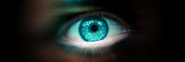 Future eye concept. Close up of a man's eye. Radial blur as a concept of movement. Banner with a dark background and an eye inside. Fotomurales