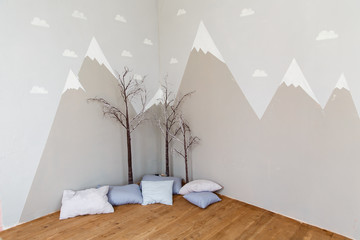 Playing room for a boy. Stylish kid room with illustration of mountains and bungee. Mountains illustration in a child room