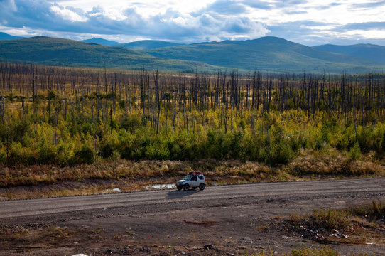 4x4 SUV during the autumn expedition in difficult conditions.
