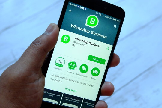 BANDAR SERI BEGAWAN,BRUNEI - JULY 25TH,2018 : A male hand holding smartphone with Whatsapp Business apps on an android Google Play Store