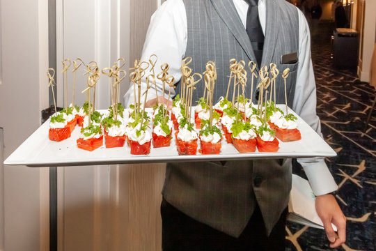 tray of hors d'oeuvres presented by waiter