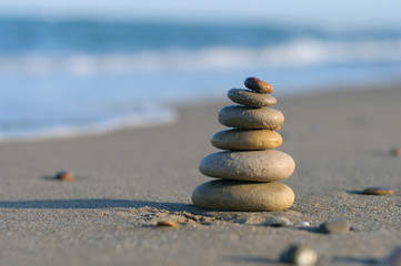 Acrylic Prints Stones in Sand stones on the beach in the form of a pyramid