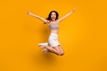 Turned full length body size photo of cheerful overjoyed excited woman screaming yeah winning prize isolated vivid color background