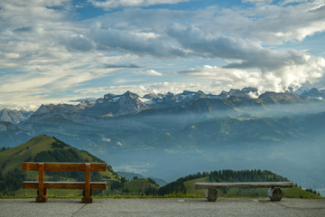 Two benches with beautiful view on Swiss Alps on top of Mount Rigi
