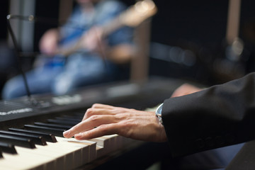 hands playing piano close-up
