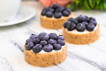 cake with blueberries and raspberries