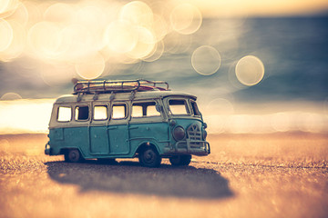 Foto auf Acrylglas Retro Vintage miniature van in vintage color tone, travel concept