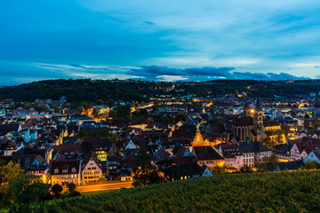 Germany, Aerial view above skyline of medieval city esslingen am neckar, roofs, houses, st dionysius church and streets by night illuminated by night