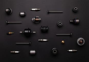 Studio photography - a lot of automotive parts: valves, spark plugs, silent blocks, thermostats,...