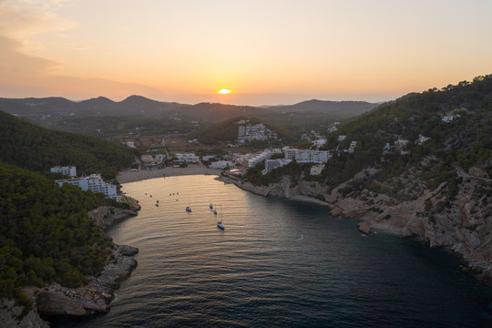 Aerial view of the coastline of Ibiza island during sunset.