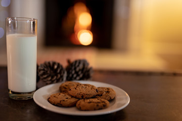 Cookies and milk on table at Christmas time