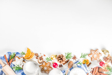 Christmas baking background. Christmas sweet cooking ingredients on white table. Ingredient for cooking christmas pastry, cookies and cakes, Flatlay on white table, top view with copy space