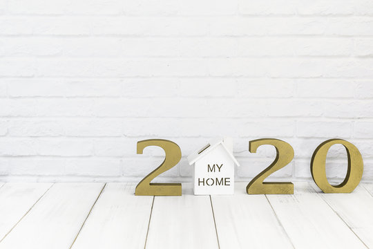 2020 new year and home  on white wood table over white background with copy space , Real estate concept