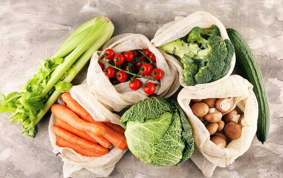 eco natural bags with vegetables, eco friendly, flat lay. sustainable lifestyle concept. zero waste vegetables shopping. plastic free items. reuse, reduce, recycle, refuse