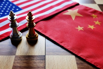 Chess game. Two kings face to face on Chinese and American national flags. Trade war and conflict between two big countries. USA and China relationship concept.