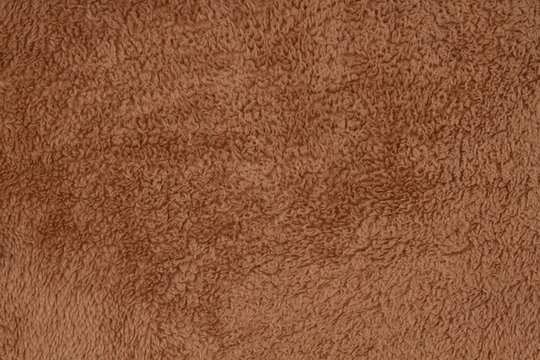 Brown sherpa textured plush fabric material background