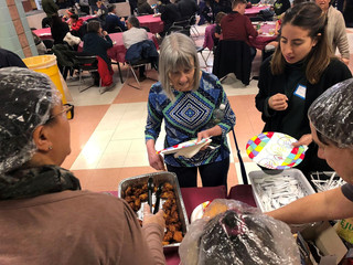 Furloughed government workers, contractors and their families attended a free community dinner donated from families and community organization during the partial U.S. government shutdown in Silver Spring, Maryland