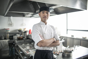 Portrait of a handsome asian chef Wall mural