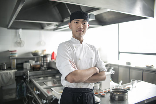 Portrait of a handsome asian chef
